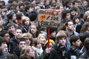 French high school students carry a sign and shout slogans during a demonstration in Rennes December 18, 2008